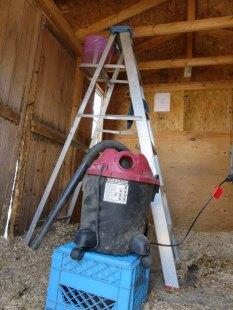 R2D2 shop vac perched on a milk carton.