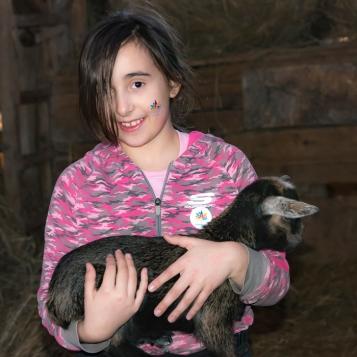 Kyla with baby goatie